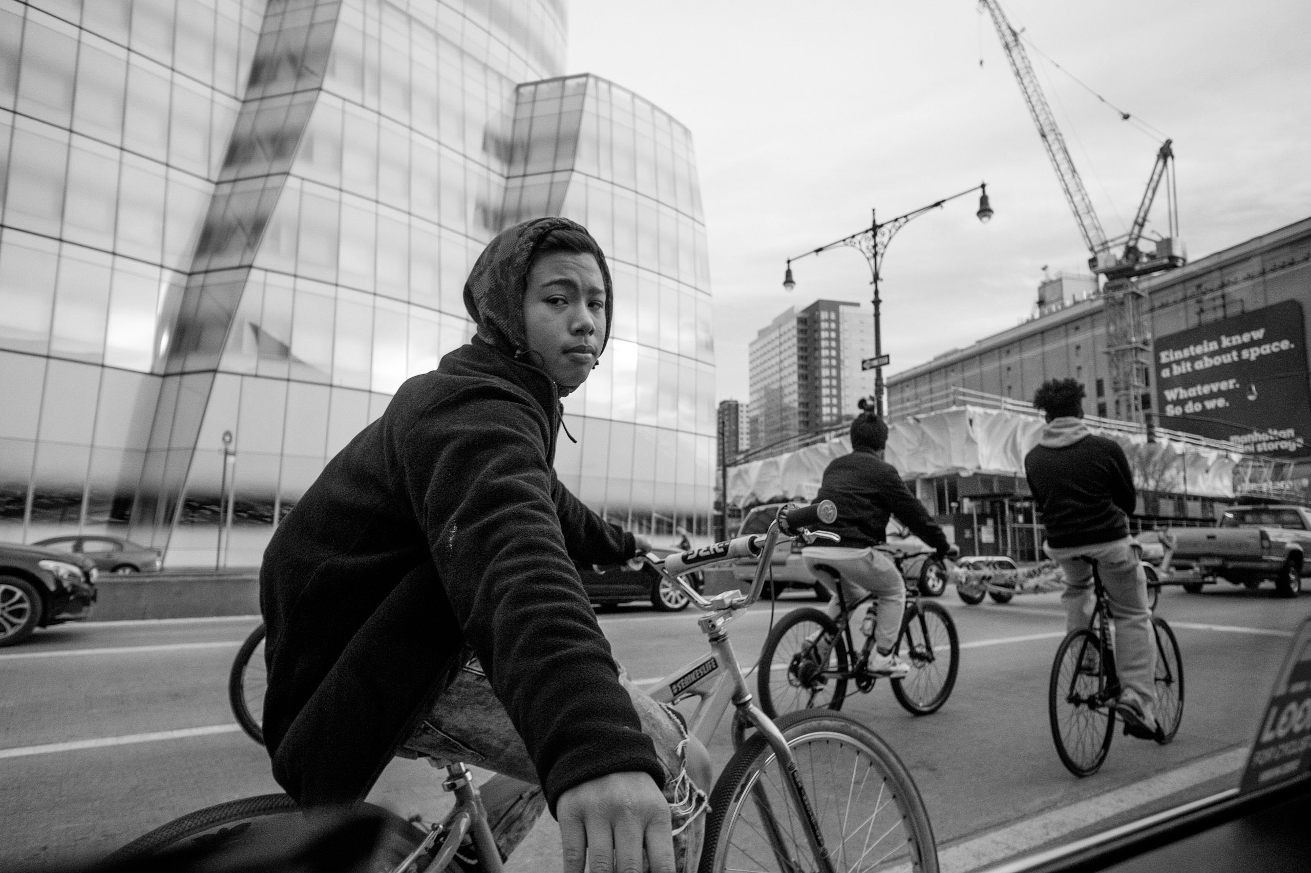 bicyclist-hitching-onto-taxi-west-side-hwy-nyc-black-and-white-photography